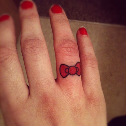 Cute little bow tattoo pinpoint for Cute bow tattoos