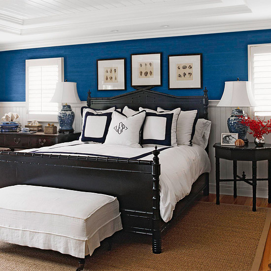 blue room with white trim and black bed pinpoint
