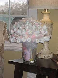Diaper bouquet! The new diaper cake – This is REALLY cute!!!  I would MUCH rathe