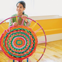 weave a small rug using old t-shirts and a hula hoop!