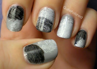 Finger print nails. Base coat, then brush a little paint on two fingers: one col
