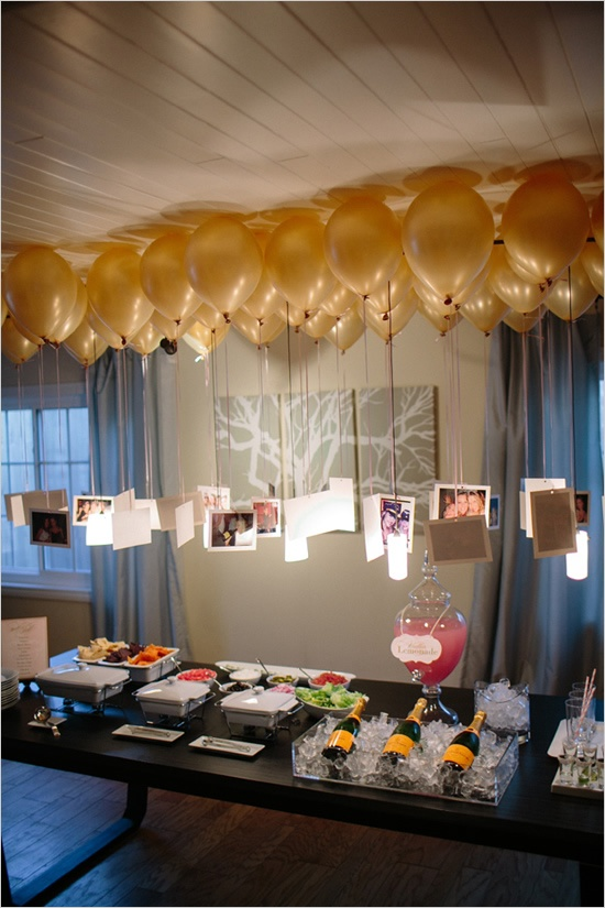 photos hanging from balloons to create a chandelier over a table. Fun!