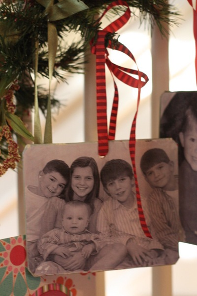 A family photo ornament for every year – photo Mod Podged onto a thin wooden pla