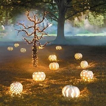 white pumpkin lights to line a path.