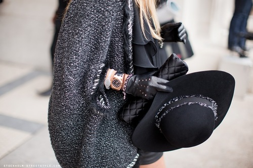 cape and black accessories