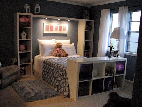 instead of a headboard…… bookshelves framing the bed, and especially love th