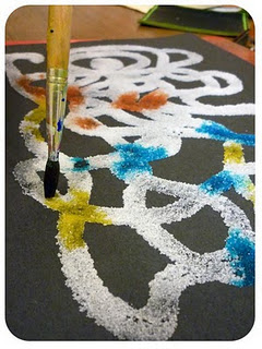 Salt painting. Make a glue design on dark paper, coat with salt, gently touch th