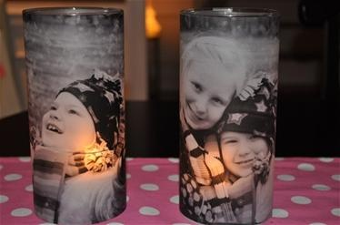 Vases found at Dollar Tree. Then you print the photos on vellum and mod podge th