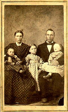 Family photo….Father is holding deceased child.