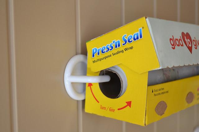 Hang your rolls onto your pantry door with plastic hooks…