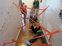 Shut. The. Front. Door. THIS IS AN AWESOME IDEA. Spy Training with tape lazers t