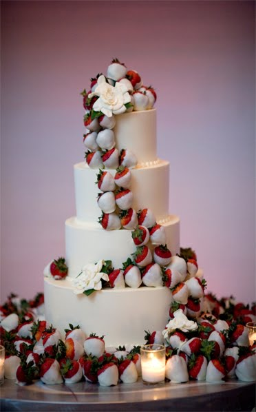 Instead of flowers on a wedding cake do chocolate covered strawberries!! So neat