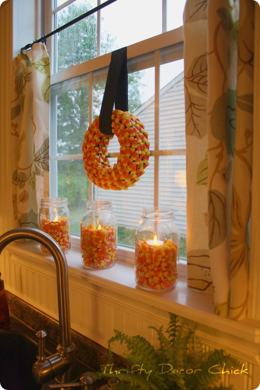 Fill Mason jars with Candy Corn & stick a tea light in there. Fall decor alo