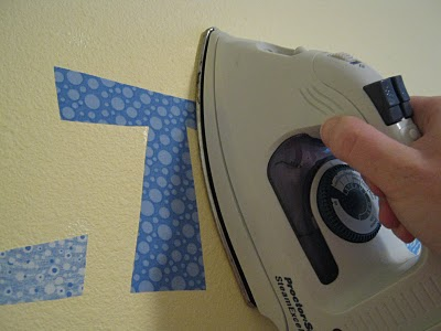 Who knew? You can actually iron fabric to the wall and it will peel right off wh