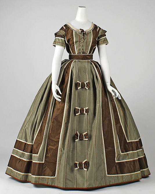 ca 1866 – silk dress – The stripes on this dress are a couched embroidery effect