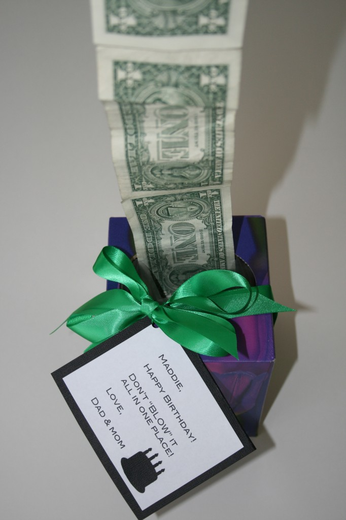 All you need is an empty Kleenex box. Oh, and cash. Dollar bills. Tape the dolla