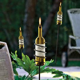 Recycle empty wine bottles into garden torches – great for an outdoor party