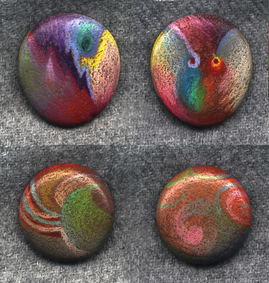 colored pencil on rocks!  (looks like dichroic glass!)  SBG thinks you can spray