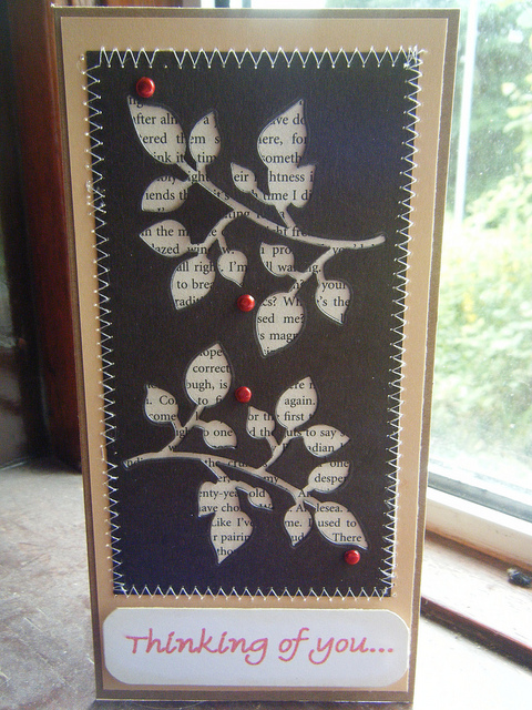 neat way to use the negative of a die cut; using old book pages behind— for ca