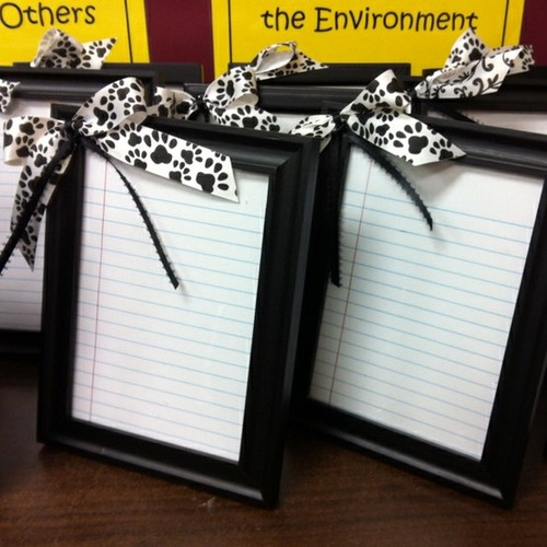 frame notebook paper, hot glue a bow, write with a dry erase marker … viola! P