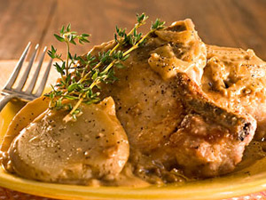 Pork Chops slow cooked in a rich gravy with potatoes.