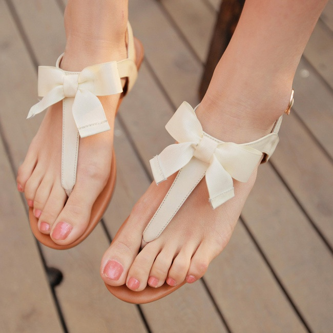 cream sandals with bows