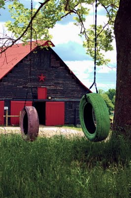 A barn and a couple of old tire swings.