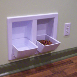 Built-in food dishes. Soooo awesome! No more doggie bowls to move around when sw