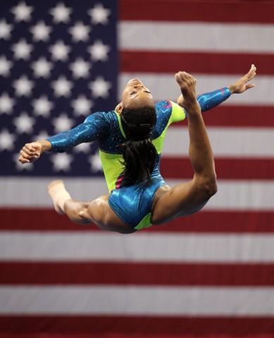 Gabby Douglas warms up during day two of the 2012 Gymnastic Championships in St.