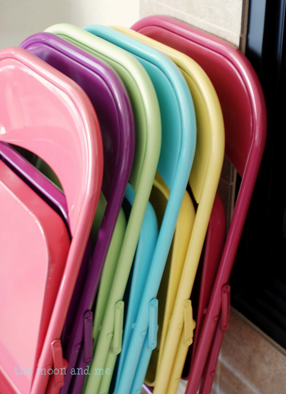 LOVE this idea!! spray paint your folding chairs….