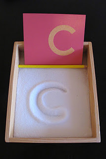 Writing letters in salt (this site has Montessori & Montessori-inspired acti
