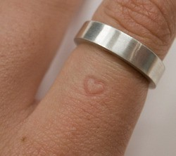 The longer you wear the ring, the heart will permanently leave a mark on the fin