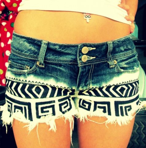 Cut the shorts, dip them in bleach, and use fabric paint for a pattern!