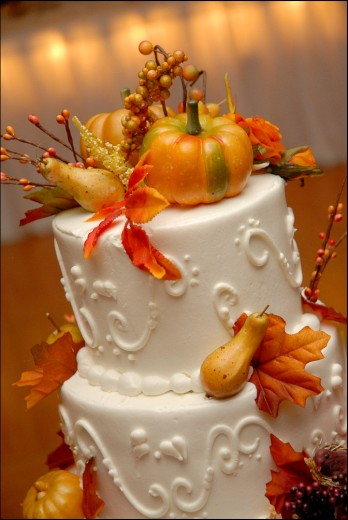 For this fall wedding, the cake is decorated with fall leaves, gourds, pumpkins,