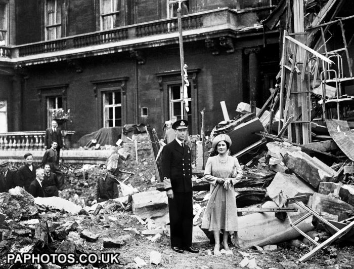 The King and Queen stand amid the bomb damage at Buckingham Palace during WWII.