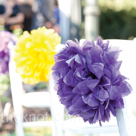The bride added bursts of purple and yellow to the wedding aisle with large tiss