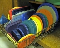 Use a dish drainer to organize pot lids, or Tupperware lids in a cabinet.  You c