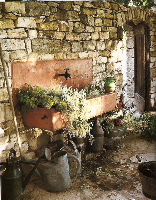 stone sink and watering cans