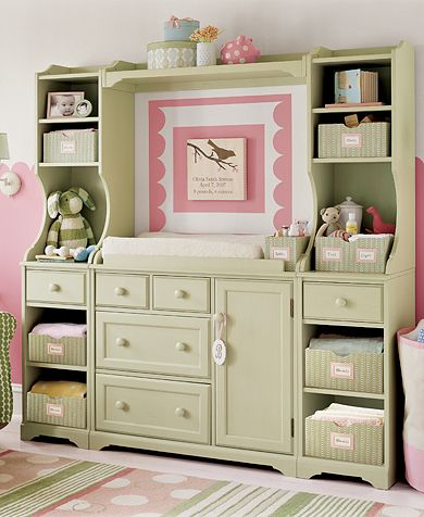 An entertainment center turned into a changing table. How beautiful!
