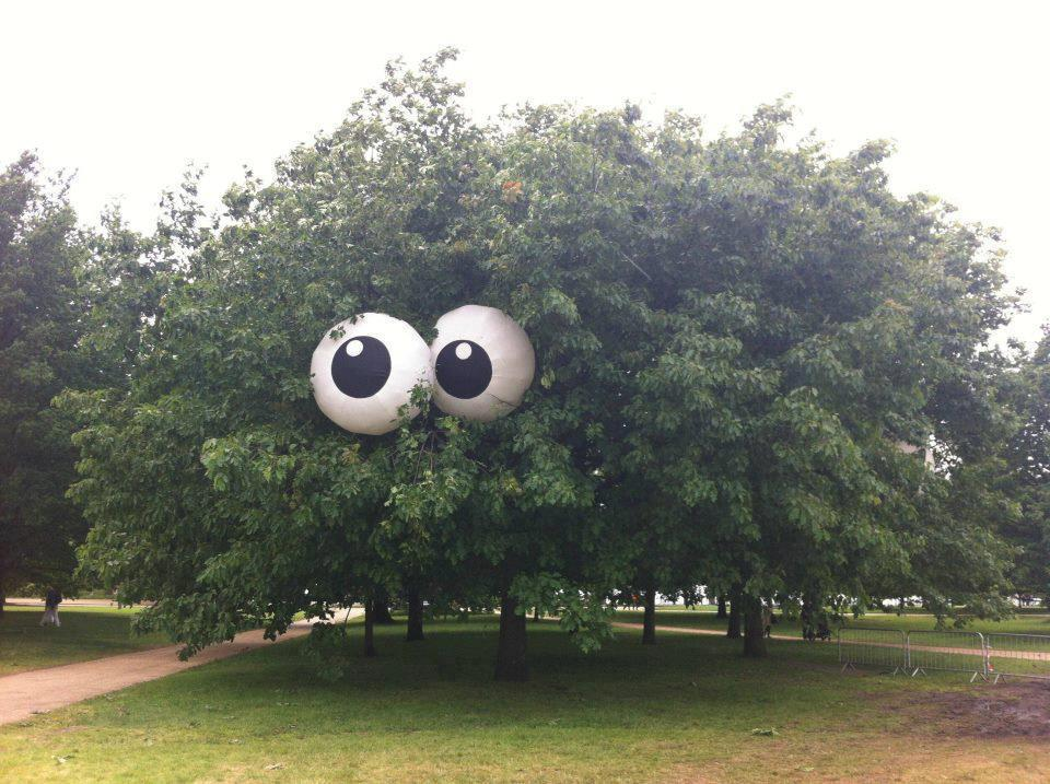 Beach balls painted to look like eyes put in a tree. Would be even spookier with