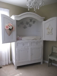 TV armoire repurposed into diaper changer. Super cool idea with built in storage