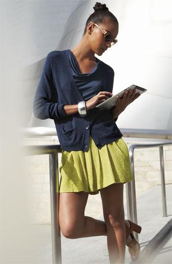 Navy cardigan and lime skirt