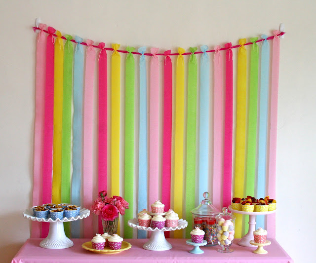 Sweet and simple backdrop idea – strips of crepe paper!
