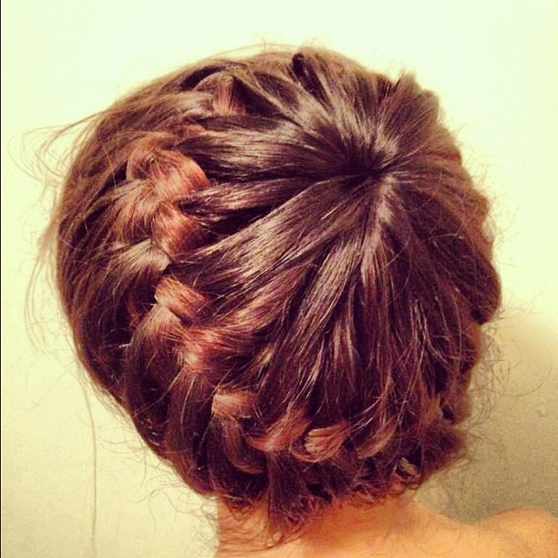 Make a ponytail in the middle of your head leaving an equal amount of hair out a
