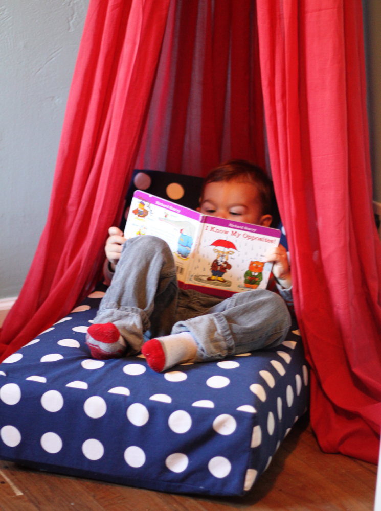 Use your old crib mattress for an upcycled reading nook!