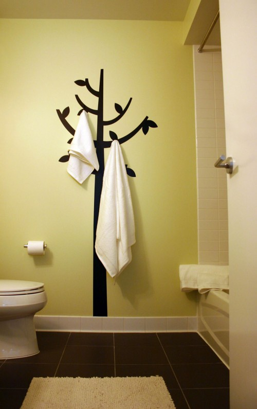 Paint the tree and add the hooks.