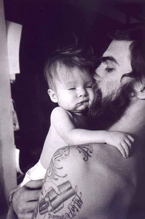 Tattooed father.  Love it.