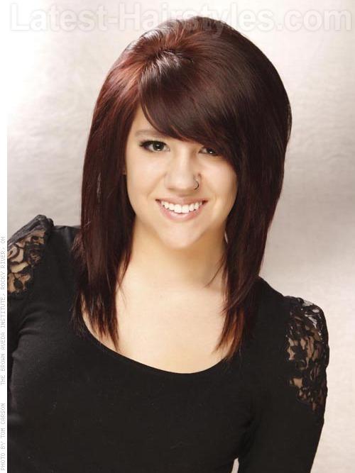 A medium haircut with dark red hair color