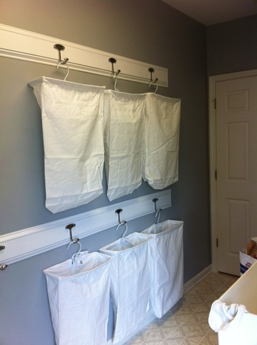 Save floor space and sort laundry on the wall. Perfect for a very small laundry