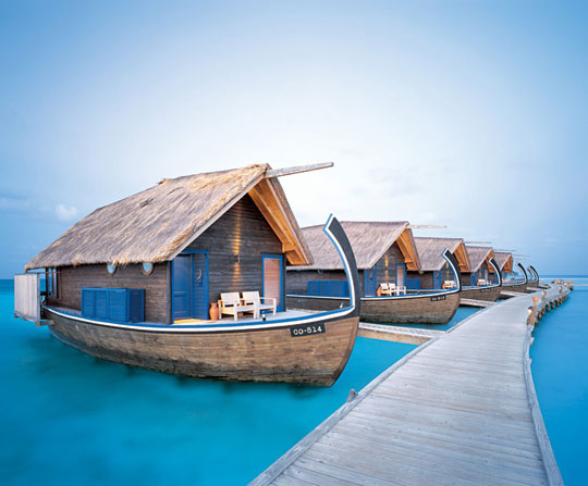 Cocoa Island's 23-room hotel with suites resembling local dhoni fishing boat